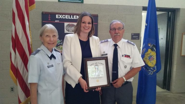 Katrina being presented with an award by the Civil Air Patrol